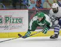 Dmitry Sokolov of the Sudbury Wolves gets taken down by Marcus Dickerson of the Mississauga Steelheads during OHL action from the Sudbury Community Arena on Saturday night.Gino Donato/The Sudbury Star