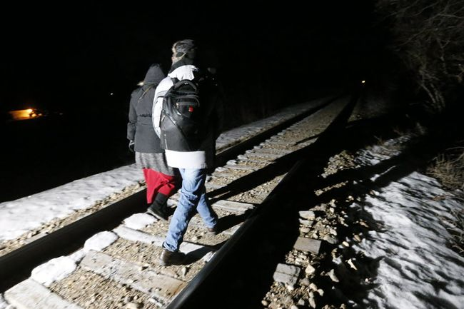 Early on Feb. 26, migrants from Somalia cross into Canada illegally from the United States. They walked down a train track into the town of Emerson, Man., to seek asylum at Canada Border Services Agency. (THE CANADIAN PRESS)