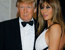 Donald Trump, left, and Melania Trump arrive for the White House Correspondents Dinner in Washington