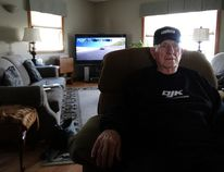 Doug Kennington watches his son D.J. Kennington race in the Daytona 500. (JANE SIMS, The London Free Press)