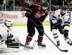 London Nationals goalie Trenton McGrail makes a save on Chatham Maroons' Alec MacKenzie as Nationals' Derek Di Iorio watches in the first period at Chatham Memorial Arena on Sunday, Feb. 26, 2017. (MARK MALONE/The Daily News)