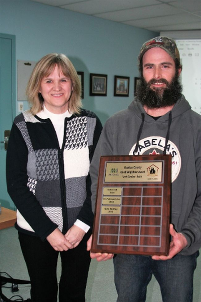 <p>Mike Barkley was presented with the 2016 Linking Hands Dundas County Good Neighbour Award, by House of Lazarus executive director Cathy Ashby. </p><p> Handout/Cornwall Standard-Freeholder/Postmedia Network