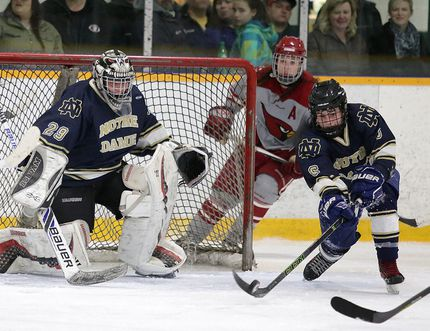 Notre Dame Alouettes defenceman Jaymes Green defelects the puck in front of goalie DJ Leblond during boys high school city championship action against the St. Charles Cardinals. Notre Dame swept St. Charles in 3 games to clain the championship. Gino Donato/The Sudbury Star