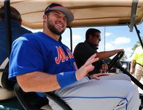 New York Mets outfielder and former NFL quarterback Tim Tebow leaves a news conference at the baseball teams spring training facility in Port St. Lucie, Fla., Monday, Feb. 27, 2017. (AP Photo/John Bazemore)
