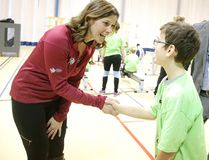 Catriona LeMay Doan, a member of the Canada Games bid evaluation committee, talks to Mateo Signoretti at Laurentian University in Sudbury, Ont. on Monday February 27, 2017. Students from area schools were on hand for a mini-summer games to welcome the Canada Games bid evaluation committee for Sudbury's bid for the 2021 Canada Summer Games. Gino Donato/Sudbury Star/Postmedia Network
