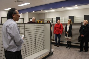 Dentist Derek Haruta, left, spent years developing the new Elmdale Health Centre that will be home to his practice and eight family doctors. St. Thomas Mayor Heather Jackson, third from right, and other community leaders toured the centre Friday, Feb. 24. (JONATHAN JUHA/POSTMEDIA NETWORK)