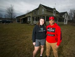 Ruby Benner and Jayden Hannigan outside the home of Ruby's father in Port Colborne. Vandals broke into the house and sprayed racist slurs on the walls of Ruby's bed room on Feb. 15. Photo by Julie Jocsak.