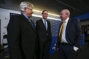 Toronto Argonauts' owner Larry Lanenbaum (right) with Jim Popp (left) and Marc Trestman during Tuesday's news conference. (JACK BOLAND/TORONTO SUN)