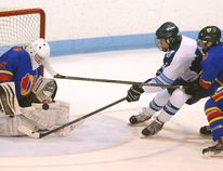 Brandon Sanders of the Lucas Vikings defended by Matt Poulin of the Oaks tries to get a puck past Ryan Murray during the second game of their TVDSB AAA hockey final at Thompson arena on Tuesday February 28, 2017. Game is tied 1-1. Mike Hensen/The London Free Press/Postmedia Network