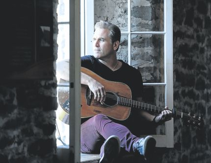 Sean McCann performs at St. Andrew's United Church in Cochrane on March 4.