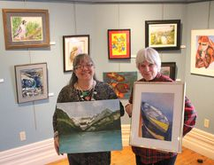 Local artists Patti Cook and Lynne Kenneith Brogden show off two pieces from the exhibit My Canada! at the Lawrence House Centre for the Arts Wednesday. Close to 50 different works from members of the Sarnia Artists' Workshop are featured in the new exhibit set to run for the month of March. Cook is pictured here holding a Jean Poole painting called Lake Louise, Alberta, while Brogden is holding a Liz Rogers painting called Waiting. Barbara Simpson/Sarnia Observer/Postmedia Network
