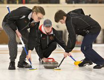 Neil McPhail (left) and Ben Jones sweep for North Park Collegiate's vice Carter Bryant during the CWOSSA high school curling championship game on Wednesday at the Brant Curling Club. (Brian Thompson/The Expositor)