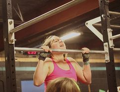 At the first CrossFit open last year, Keri-Ann Schedewitz rose above the bar during a set of chest-to-bar pull-ups.(Shaun Gregory/Huron Expositor)