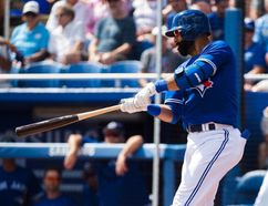 Toronto Blue Jays right fielder Jose Bautista (19) hits a foul ball against the Detroit Tigers during first inning Grapefruit baseball spring training action in Dunedin, Fla., on Wednesday, March 1, 2017. (THE CANADIAN PRESS/Nathan Denette)