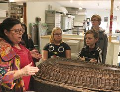 BRUCE BELL/THE INTELLIGENCER Glanmore Historic Site acting curator Melissa Wakeling shows students from the Queen Elizabeth Grade 7-8 Student Leadership program a body basket on Thursday afternoon. As part of Takeover Day, the students will be running the museum on Saturday.