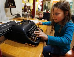 Mattea Blair tries her hand at a Remington typewriter while Ryder Samarin looks on at the Grande Prairie Museum on Sunday, May 18, 2014. The museum was open for free on Sunday in celebration on International Museum Day. TOM BATEMAN/DAILY HERALD-TRIBUNE/POSTMEDIA NETWORK