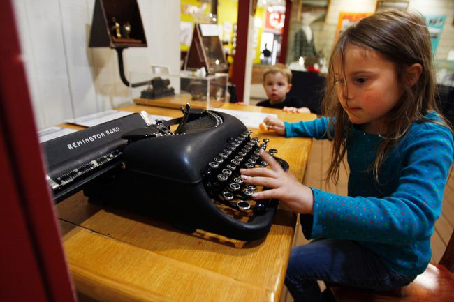 Mattea Blair tries her hand at a Remington typewriter while Ryder Samarin looks on at the Grande Prairie Museum on Sunday, May 18, 2014. The museum was open for free on Sunday in celebration on International Museum Day. 