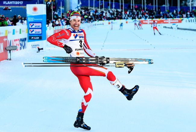 Canada's Alex Harvey celebrates after winning the men's cross-country 50 km freestyle mass start skiing competition in the FIS Nordic World Ski Championships in Lahti, Finland, on March 5, 2017.  (JONATHAN NACKSTRAND/AFP/Getty Images)