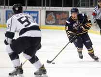 Logan Clow/Daily Herald-Tribune Forward Connor Blake, right, of the Grande Prairie Storm, skates the puck through the neutral zone against the Sherwood Park Crusaders on Friday March 3 at Revolution Place in Grande Prairie. The Storm lost 4-3 in overtime and then lost 3-0 on Saturday against the Bonnyville Pontiacs to wrap their regular season. The team opens playoffs on March 9.