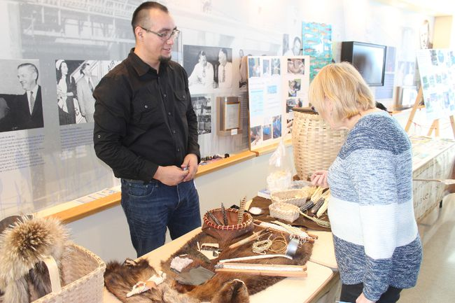 Eric Sunday, behind his exhibit at the Akwesasne Cultural Restoration table, at the Great St. Lawrence River Roundtable on Saturday.