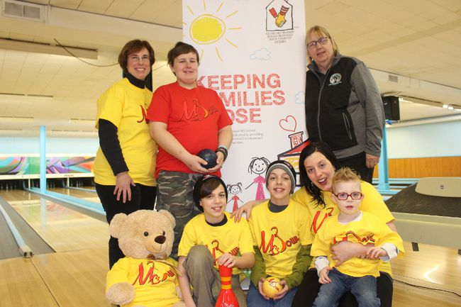 At the ceremonial launch of McBowl for Ronald McDonald House are, in front from left, twin brothers Cameron Laird and Connor Laird, with mom Mallory Ouellette and son Darby Hazlett. In back are Cheryl Tourangeau, her son Alex Tourangeau and Quilles Nativite Lanes manager Janet Wheeler.