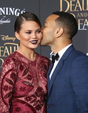 Chrissy Teigen and John Legend attend the premiere of Disney's 'Beauty and the Beast' at the El Capitan Theater in Los Angeles, March 2, 2017. (FayesVision/WENN.COM)