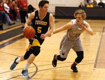 Parker Toppings, right, of the GPRC Wolves men's basketball team, tries to guard Concordia University of Edmonton Thunders' Brett Jakubec, in Alberta Colleges Athletic Conference play on Feb. 24 at Grande Prairie Regional College. Logan Clow/Daily Herald-Tribune