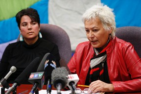 Angie Hutchinson (left), Ka Ni Kanichihk, Family Support Coordinator and Missing and Murdered Indigenous Women and Girls (MMIWG) Coalition member, listens in as Sandra Delaronde, Executive Director of the Indigenous Women's Research Institute, MMIWG Coalition co-chair expresses her concerns about the national inquiry into murdered and missing indigenous women and girls in Winnipeg, Tuesday, March 7, 2017. (THE CANADIAN PRESS/John Woods)