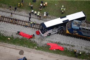 Responders work the scene where a train hit a bus in Biloxi, Miss., Tuesday, March 7, 2017. (AP Photo/Gerald Herbert)