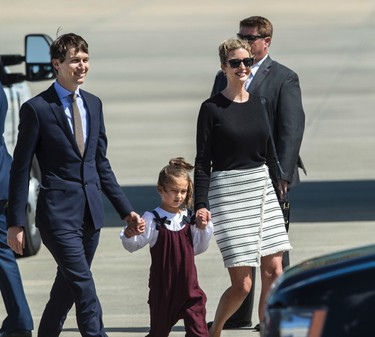 Ivanka Trump, pictured with her husband White House senior adviser Jared Kushner and their daughter Arabella, wears a striped skirt from her fashion line at Orlando International Airport in Orlando, Fla., Friday, March 3, 2017. (AP Photo/Willie J. Allen Jr.)