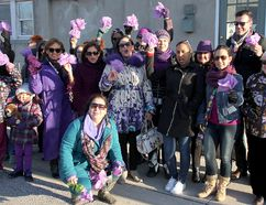 Participants are shown during a walk to commemorate International Women's Day in Chatham on Wednesday. (Trevor Terfloth/The Daily News)