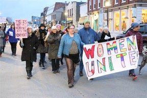 BRUCE BELL/THE INTELLIGENCER It was loud on Picton's Main Street on Wednesday evening as 40 people — mostly women — marched the length of the street in celebration of International Women's Day.