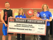 Pat Fletcher, left, general manager of GoodLife Fitness on Lasalle , Nicole Graham, physiotherapist at the Children's Treatment Centre, James Butcher, a 2016 iCan Bike participant, and Penny Jacob, a physiotherapist at Children's Treatment Centre, take part in a donation to the CTC. Supplied photo