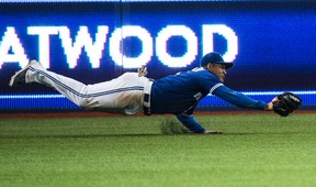 Toronto Blue Jays Ezequiel Carrera makes a diving catch against the Oakland A's at Rogers Centre in Toronto on April 23, 2016. (Craig Robertson/Toronto Sun)