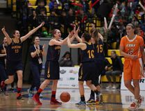 Queen's Gaels players celebrate their 60-51 win over the Cape Breton Capers in a quarter-final game at the U Sports national women's basketball championship tournament in Victoria on Thursday. (Chad Hipolito/The Canadian Press)