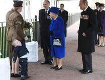 Michelle Lunn, left, holds on to her son Alfie, 2-years-old as they meet Britain's Queen Elizabeth II at the unveiling during the the unveiling of a national memorial honouring the Armed Forces and civilians who served their country during the Gulf War and conflicts in Iraq and Afghanistan in London Thursday March 9, 2017. Britain's Prince Philip stands at right(Toby Melville/Pool Via AP)