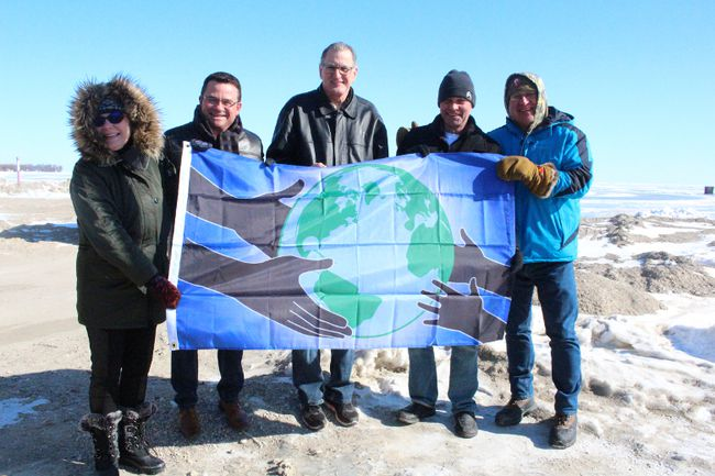 From left: Coun. Thora Palson, Gimli MLA Jeff Wharton, Coun. Danny Luprypa, Bruce Benson and Mayor Randy Woroniuk pose with the Flag of Humanity March 10. (Juliet Kadzviti/The Interlake Spectator/Postmedia Network)