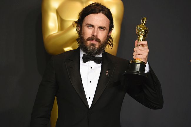 "Casey Affleck poses in the press room with the award for best actor in a leading role for ""Manchester by the Sea"" at the Oscars at the Dolby Theatre in Los Angeles. (Associated Press)"