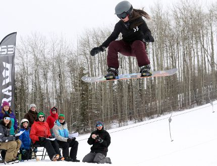 Kayla Milne, 15, goes airborne off a jump as judges watch her performs a trick on her snowboard during the S3 Boardshop Super Jam slopestyle competition on Saturday March 11, 2017 at Nitehawk Year-Round Adventure Park, 10km south of Grande Prairie, Alta. Snowboarders were awarded points based on their tricks. Logan Clow/Grande Prairie Daily Herald-Tribune/Postmedia Network