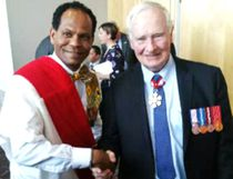 Proudly wearing the Sovereign Medal for Volunteers he received last year, Geza Wordofa poses for a picture with Governor General David Johnston at this year's award ceremony in London March 9. (Contributed Photo)