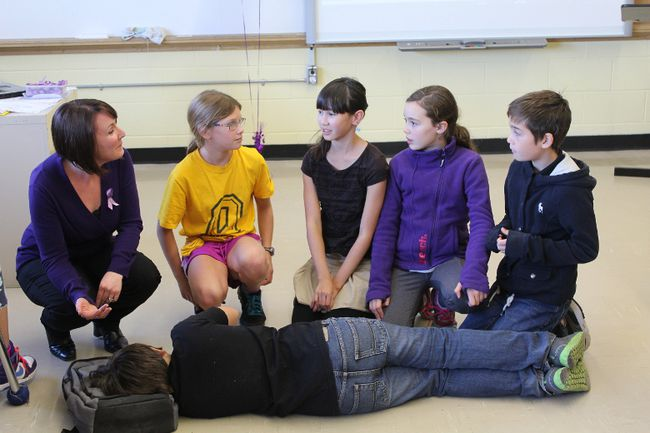 "Claire Notman, left, education co-ordinator with Epilepsy South Eastern Ontario, is seen with students from Central Public School during a ""Thinking About Epilepsy"" presentation. (Supplied photo)"