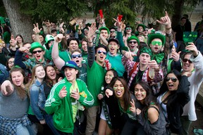 Western University students get their Irish on at a St. Patrick's Day party on Broughdale Ave. in London, Ont. on Thursday March 17, 2016. (DEREK RUTTAN, The London Free Press)