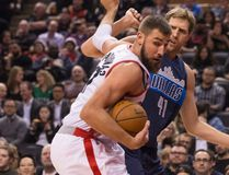 Toronto Raptors centre Jonas Valanciunas looks for space as he tries to get away from Dallas Mavericks forward Dirk Nowitzki during an NBA game on March 13, 2017. (THE CANADIAN PRESS/Chris Young)
