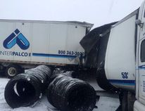 A transport truck rests in a jackknifed position with its cargo spilled at the scene of the March 14th multi-vehicle pileup and chemical spill near Lansdowne.