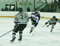 Fairview Flyers player #88 Liam Yasinski going towards GP Kings player #7 Taylor Lileikis with #12 Donald Gaudreault coming behind him during the final game of the Flyers-Kings best-of-seven series on March 11 at the Fairview Arena.
