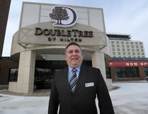 General Manager Grant McCurdy stands in front of the newly opened Doubletree Hilton Hotel (replacing the old Mayfield Hotel) in 2014. File photo.