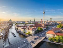 Aerial view of Berlin skyline with famous TV tower and Spree river in beautiful evening light at sunset, Germany. (Getty Images)