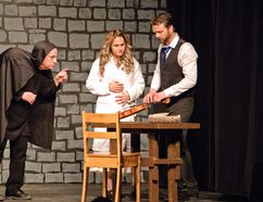 (L to R) Terry Lear, as Igor, Alix Cartwright, as Inga, and Matthew Clements, as Dr. Frederick Frankenstein are pictured during a dress rehearsal for Mel Brooks' 'Young Frankenstein' on Saturday March 11, 2017 in Peace River, Alta.