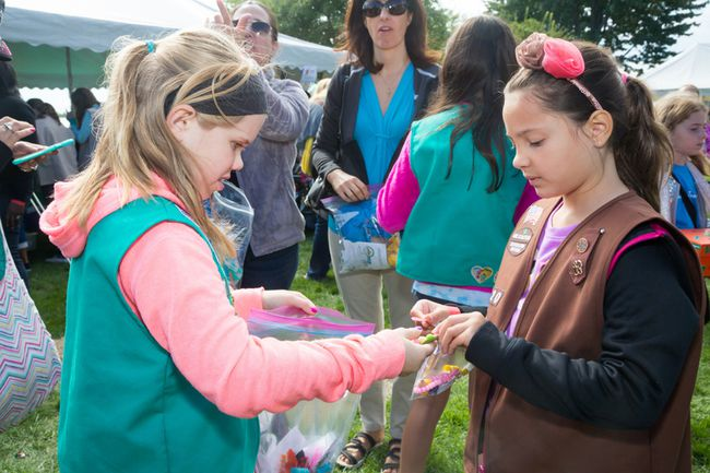Youngsters are shown making a trade during during last year's Girl Guides and Girl Scouts International River Crossing event held at Sombra and on the Michigan side of the St. Clair River. The international event has survived changes in rules at the border and plans to celebrate its 50th anniversary in September. Photo courtesy of Girl Scouts of Southeastern Michigan. 