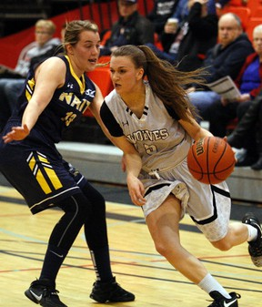Kaitlyn Verduzco, right, of the GPRC Wolves women's basketball team, tries to power her way around Cassidy Taal, of the NAIT Ooks on Friday January 20, 2017 in Alberta Colleges Athletic Conference action at Grande Prairie Regional College in Grande Prairie, Alta.